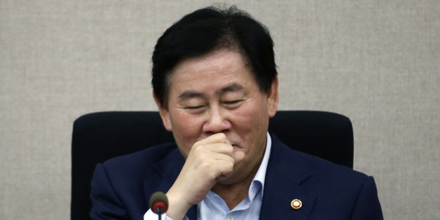 "South Korea's Finance Minister Choi Kyung-hwan reacts during a meeting with the managing committee of public institutions at the Government Complex in Seoul July 31, 2014. Three turbocharged weeks into his new job, Choi has impressed markets so much that they already talk of ""Choinomics"" as a brand of new policies aimed at revving up Asia's fourth-largest economy. Picture taken July 31, 2014.   REUTERS/Kim Hong-Ji (SOUTH KOREA - Tags: POLITICS BUSINESS)"