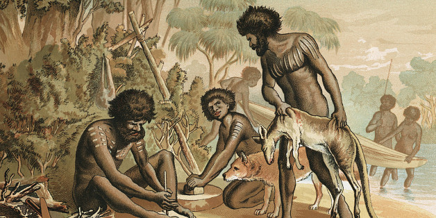 Australian aborigines with kangaroo carcass