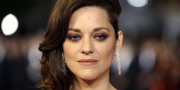"""FILE - In this May 19, 2016 file photo, actress Marion Cotillard poses for photographers upon arrival at the screening of the film Juste la Fin du Monde (It's Only the End Of The World) at the 69th international film festival, Cannes, southern France. Cotillard is announcing her pregnancy and shooting down rumors of any romantic involvement with Brad Pitt. The actress says in a statement posted Wednesday, Sept. 21, 2016, on Instagram that she is """"not used to commenting on things like this nor ta"""