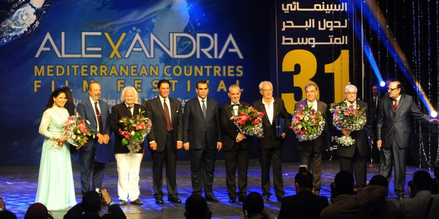 Prize winners of the Alexandria Mediterranean countries film festival stand on stage during the opening ceremony in Egypt's northern coastal city of Alexandria on September 2, 2015. AFP PHOTO / TAREK ABDEL HAMID        (Photo credit should read TAREK ABDEL HAMID/AFP/Getty Images)