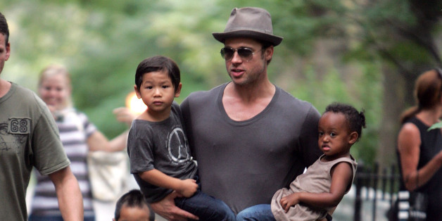 NEW YORK - AUGUST 26:  Brad Pitt visits playground with children Zahara Jolie-Pitt, Pax Jolie-Pitt and Maddox Jolie-Pitt in New York City on August 26, 2007.  (Photo by James Devaney/WireImage)
