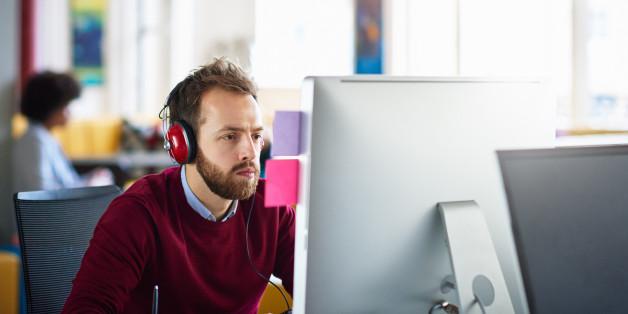Businessman on computer at office workstation