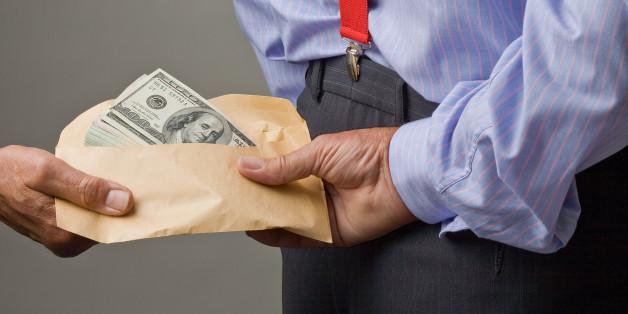 backhander of money to man.