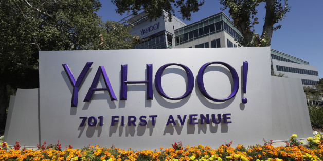 Flowers bloom in front of a Yahoo sign at the company's headquarters Tuesday, July 19, 2016, in Sunnyvale, Calif. (AP Photo/Marcio Jose Sanchez)