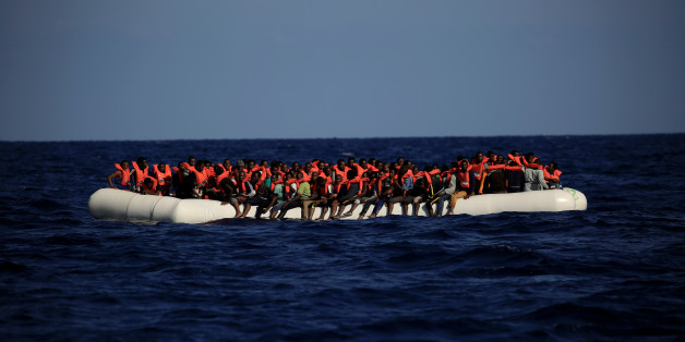 An overcrowded dinghy with migrants from different African countries is seen after members of the German NGO Jugend Rettet guided them towards the Iuventa vessel during a rescue operation, off the Libyan coast in the Mediterranean Sea  September 21, 2016. REUTERS/Zohra Bensemra