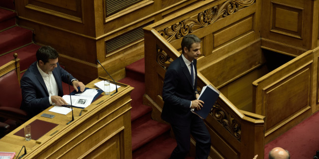HELLENIC PARLIAMENT, ATHENS, ATTIKI, GREECE - 2016/07/21: Leader of New Democracy and leader of the opposition, Kyriakos Mitsotakis (right) is passing by Greek Prime Minister Alexis Tsipras (left), at the end of his speech in Hellenic Parliament. (Photo by Dimitrios Karvountzis/Pacific Press/LightRocket via Getty Images)