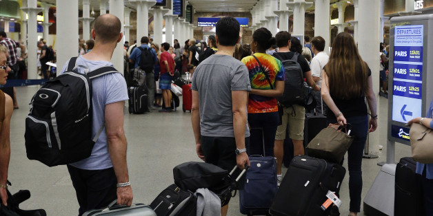 FILE- In this Thursday, July 2, 2015 file photo, people queue as they wait at the St. Pancras international train station terminal in London. Britain's immigration minister says U.K. citizens may have to pay for visas to visit European Union nations after the country leaves the bloc. (AP Photo/Frank Augstein, File)