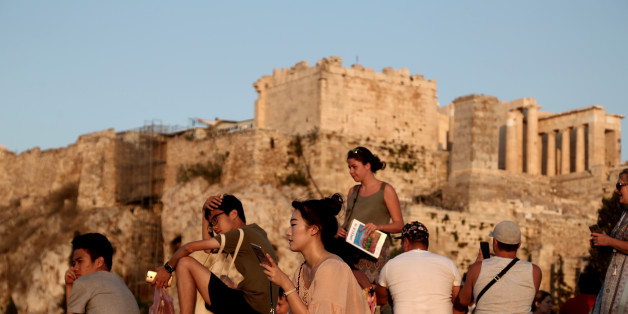Tourists at the Athens Acropolis on 26 July 2016. Andreadis president of SETE (Association of Greek Tourism Enterprises)  Greece might win  'last minute' tourists planning to go to Turkey, but ultimately because of the situation after the coup choose  Greece, however, the overall tourism development remains fragile. Earlier this year, SETE had predicted a 5% increase in tourism revenue for 2016 to 15 billion Euros and 25 million tourists (23.6 mil. Last year). (Photo by Panayiotis Tzamaros/NurPhoto via Getty Images)