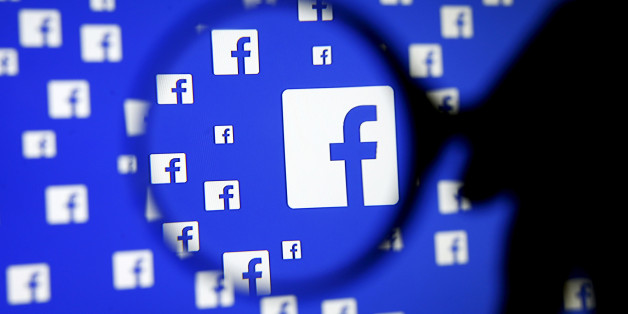 """A man poses with a magnifier in front of a Facebook logo on display in this illustration taken in Sarajevo, Bosnia and Herzegovina, December 16, 2015.   REUTERS/Dado Ruvic/Illustration/File Photo   GLOBAL BUSINESS WEEK AHEAD PACKAGE - SEARCH """"BUSINESS WEEK AHEAD JULY 25"""" FOR ALL IMAGES"""