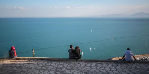 Tourists observe a panoramic view of the Gulf of Tunis from the village of Sidi Bou Said, some 20 kilometers outside of Tunis, Tunisia, Tuesday, Oct. 27, 2015. (AP Photo/Mosa'ab Elshamy)