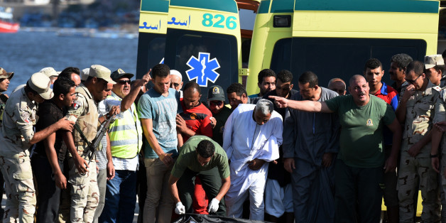 Egyptian medics covers the body of a migrant along the shore in the Egyptian port city of Rosetta on September 22, 2016, during a search operation after a boat carrying migrants capsized in the Mediterranean.A boat carrying up to 450 migrants capsized in the Mediterranean off Egypt's north coast, drowning 42 people and prompting a search operation that rescued 163 passengers, officials said. / AFP / MOHAMED EL-SHAHED        (Photo credit should read MOHAMED EL-SHAHED/AFP/Getty Images)