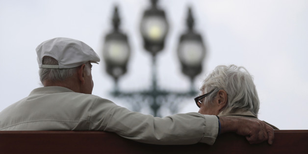 A retired couple sits on a bench in Enghien-les-Bains, north of Paris, August 26, 2013. France's government, which has been meeting with labour union heads about retirement issues, neared a deal with trade unions on Monday to overhaul the pension system via a slight lengthening of working lives, union chiefs said, as Europe's number two economy sought to bring a spiralling deficit under control. REUTERS/Christian Hartmann (FRANCE - Tags: POLITICS BUSINESS EMPLOYMENT)