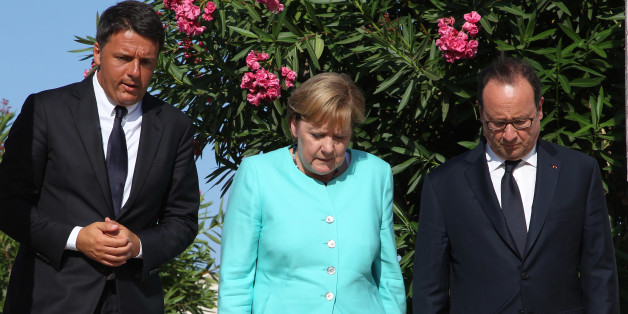 Italian Premier Matteo Renzi, left, German Chancellor Angela Merkel, center, and French President Francois Holland pay their homage at the tomb of Altiero Spinelli, one of the founding fathers of European unity, in the cemetery of the island of Ventotene, Italy, Monday, Aug. 22, 2016. Standing silently together, the three leaders placed three bouquets of blue and yellow flowers, the colors of the European Union, on the simple white marble tombstone of Altiero Spinelli in the cemetery of the island of Ventotene. (Carlo Hermann/Pool Photo via AP)