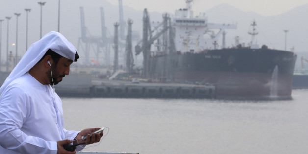 An Emirati man stands at the oil terminal of Fujairah during the inauguration ceremony of a dock for supertankers on September 21, 2016.The oil terminal at Fujairah inaugurated a dock for supertankers, the first of its kind in OPEC member the United Arab Emirates. The facility enables the terminal to receive tankers measuring 334 metres (yards) and weighing 330,000 tonnes, port director Mussa Murad said. / AFP / KARIM SAHIB        (Photo credit should read KARIM SAHIB/AFP/Getty Images)