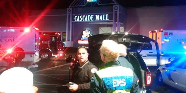 Medics wait to gain access to the Cascade Mall after four people were shot dead in Burlington, Washington, U.S. September 24, 2016.  Sgt Mark Francis/Washington State Patrol/Handout via Reuters ATTENTION EDITORS - THIS IMAGE WAS PROVIDED BY A THIRD PARTY. EDITORIAL USE ONLY. FOR EDITORIAL USE ONLY. NOT FOR SALE FOR MARKETING OR ADVERTISING CAMPAIGNS. THIS IMAGE HAS BEEN SUPPLIED BY A THIRD PARTY. THIS PICTURE WAS PROCESSED BY REUTERS TO ENHANCE QUALITY. AN UNPROCESSED VERSION HAS BEEN PROVIDED S
