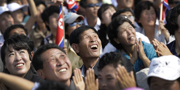 North Koreans watch an aerial display on Saturday, Sept. 24, 2016, in Wonsan, North Korea. North Korea on Saturday opened an air festival featuring sky diving, demonstrations by its air force and lots of beer to promote a newly renovated and upgraded commercial airport in the coastal city of Wonsan that it hopes will draw for foreign tourists. (AP Photo/Wong Maye-E)