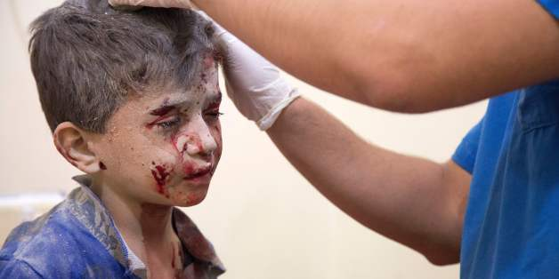 A Syrian boy receives treatment at a make-shift hospital following air strikes on rebel-held eastern areas of Aleppo on September 24, 2016.Heavy Syrian and Russian air strikes on rebel-held eastern areas of Aleppo city killed at least 25 civilians on Saturday, the Britain-based Syrian Observatory for Human Rights said, overwhelming doctors and rescue workers. / AFP / KARAM AL-MASRI        (Photo credit should read KARAM AL-MASRI/AFP/Getty Images)