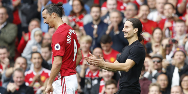 """Britain Football Soccer - Manchester United v Leicester City - Premier League - Old Trafford - 24/9/16Manchester United's Zlatan Ibrahimovic as a fan invades the pitchAction Images via Reuters / Carl RecineLivepicEDITORIAL USE ONLY. No use with unauthorized audio, video, data, fixture lists, club/league logos or """"live"""" services. Online in-match use limited to 45 images, no video emulation. No use in betting, games or single club/league/player publications. Please contact your account representat"""