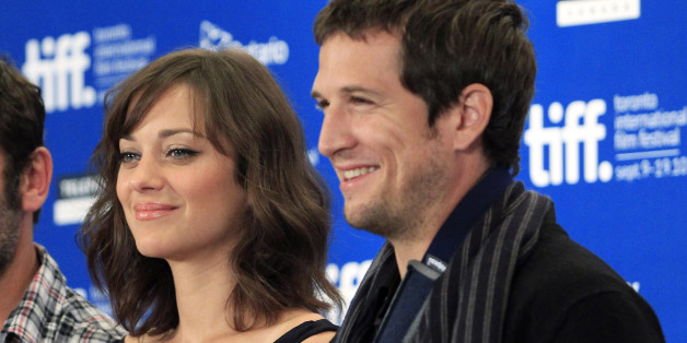 """French actors GIlles Lellouche (L), Marion Cotillard and director Guillame Canet (R) pose for photos during the news conference for the film """"Little White Lies"""" at the 35th Toronto International Film Festival September 12, 2010. REUTERS/Mike Cassese  (CANADA - Tags: ENTERTAINMENT PROFILE)"""