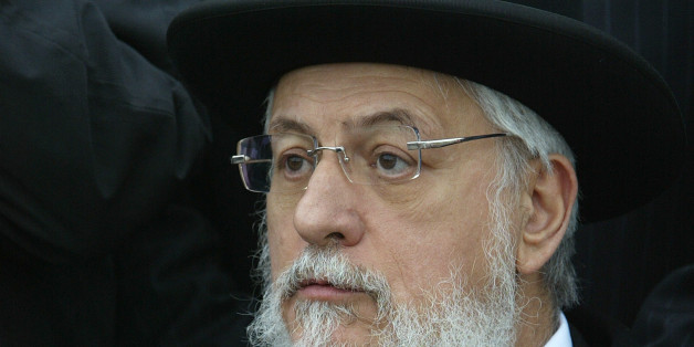 Chief Rabbi of France Joseph Sitruk attends a ceremony near the Jewish cemetery of Herrlisheim, Eastern France, May 6, 2004. 127 graves, desecrated by vandals with Nazi swastikas and anti-semitic slogans written in German, were found last April 30 in this graveyard. REUTERS/Vincent Kessler  VK/ANB/CRB