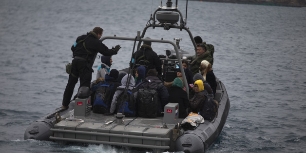 In this photo taken on Wednesday, Jan. 20, 2016, a Frontex speedboat with a Dutch crew transfers about 25 refugees and migrants from the deserted Greek island of Pasas to the nearby island of Oinousses, near Chios island. Chios, second in the number of arrivals after Lesbos, has three coast guard vessels as well as Frontex reinforcements. Hour after hour, by night and by day, Greek coast guard patrol and lifeboats, reinforced by vessels from the European Union's border agency Frontex, ply the waters of the eastern Aegean Sea along the frontier with Turkey, on the lookout for people being smuggled onto the shores of Greek islands - the frontline of Europe's massive refugee crisis.  (AP Photo/Petros Giannakouris)