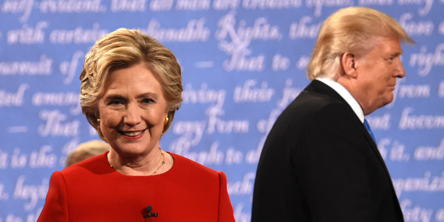 Democratic nominee Hillary Clinton (L) and Republican nominee Donald Trump leave the stage after the first presidential debate at Hofstra University in Hempstead, New York on September 26, 2016. / AFP / Timothy A. CLARY        (Photo credit should read TIMOTHY A. CLARY/AFP/Getty Images)
