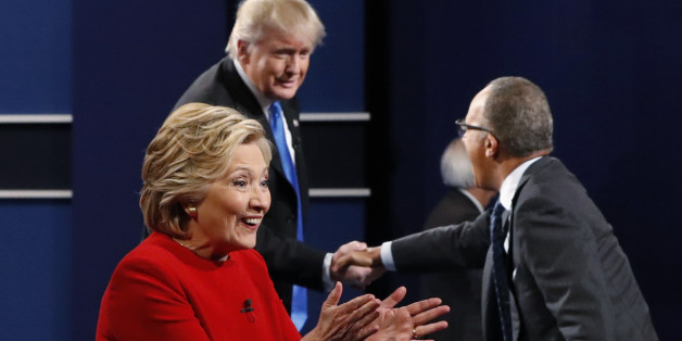 Democratic U.S. presidential nominee Hillary Clinton greets supporters as Republican U.S. presidential nominee Donald Trump greets moderator Lester Holt (R) after their first presidential debate at Hofstra University in Hempstead, New York, U.S., September 26, 2016. REUTERS/Brian Snyder