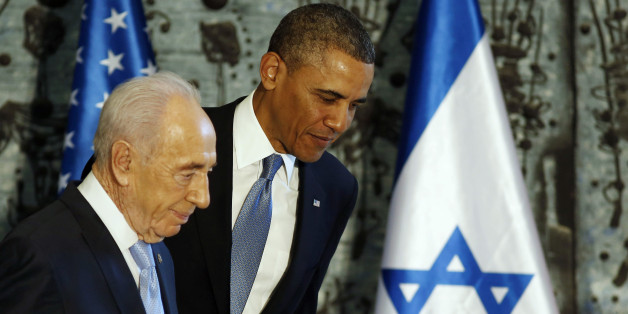 U.S. President Barack Obama (R) walks off stage together with Israel's President Shimon Peres after signing a guest book in Jerusalem, March 20, 2013. Making his first official visit to Israel, Obama pledged on Wednesday unwavering commitment to the security of the Jewish State where concern over a nuclear-armed Iran has clouded bilateral relations. REUTERS/Larry Downing  (JERUSALEM - Tags: POLITICS)