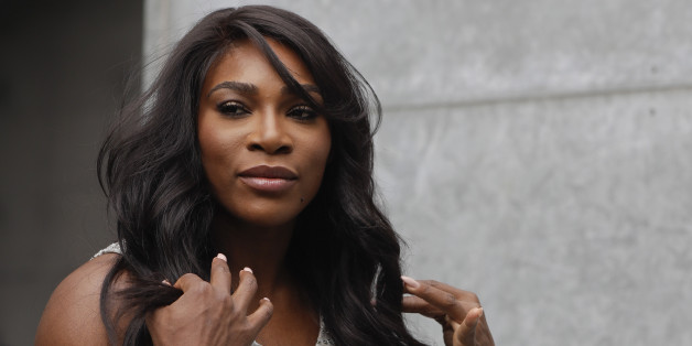 U.S. tennis star Serena Williams poses for photographers prior to the start of the Giorgio Armani women's Spring-Summer 2017 fashion show, that was presented in Milan, Italy, Friday, Sept. 23, 2016. (AP Photo/Luca Bruno)