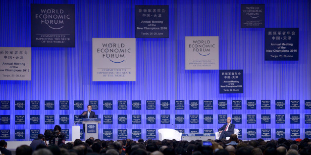 China's Premier Li Keqiang (L) gives a speech as Founder and executive chairman of the WEF Klaus Schwab (R) listens during the summer World Economic Forum in Tianjin, China, June 27, 2016. REUTERS/Wang Zhao/Pool