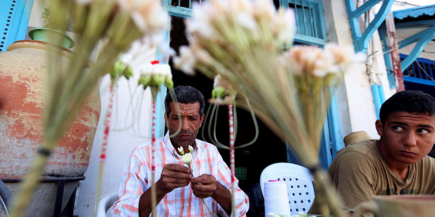A florist prepares machmoum, or jasmine bouquets, in the center of Testour, Tunisia August 31, 2016. Picture taken August 31, 2016. REUTERS/Zoubeir Souissi.