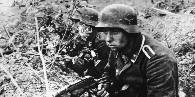 Determination and defeat are both expressed in the face of this Nazi trooper as he crouches low in a slit-trench, somewhere in Russia, on Jan. 5, 1944, waiting for the next Red army attack. (AP Photo)