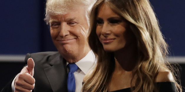 Republican presidential nominee Donald Trump walks off the stage with his wife Melania Trump, wife of Donald Trump following the presidential debate with Democratic presidential nominee Hillary Clinton at Hofstra University in Hempstead, N.Y., Monday, Sept. 26, 2016. (AP Photo/Julio Cortez)