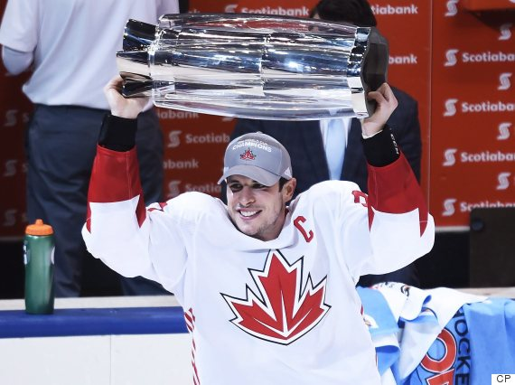 27740685316 Team Canada s Sidney Crosby hoists the trophy following his team s victory  over Team Europe on Thursday. (Photo  Nathan Denette The Canadian Press)