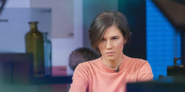 """Amanda Knox sits alone before being interviewed on the set of ABC's """"Good Morning America"""" in New York January 31, 2014. Knox vowed on Friday to fight her second conviction for the murder of British student Meredith Kercher in 2007 while the two were students together in the Italian university town of Perugia.   REUTERS/Andrew Kelly (UNITED STATES - Tags: CRIME LAW)"""
