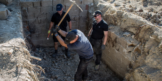 KOS, GREECE - SEPTEMBER 30:  South Yorkshire Police work to excavate a sceptic tank in search of missing toddler Ben Needham on September 30, 2016 in Kos, Greece. The 21 month old toddler from Sheffield vanished on the Greek island in July of 1991. A 19-strong team of police officers, forensic specialists and an archaeologist have been searching an olive grove next to the farm house where the child was last seen playing however excavation on parts of the site halted today after the landowner com