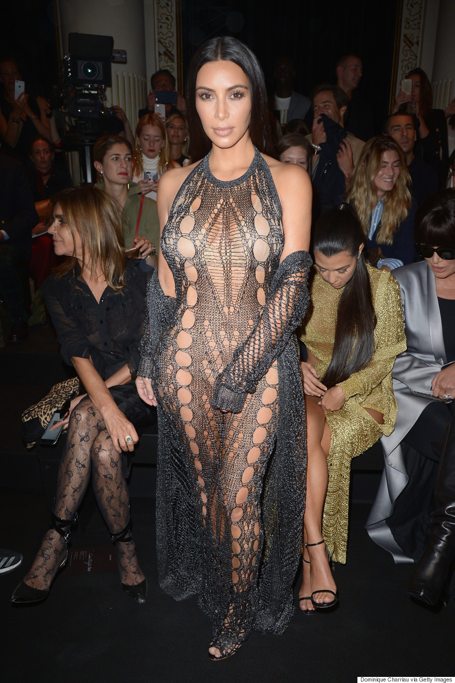 665f51a7853 Kim Kardashian Wears See-Through Mesh Jumpsuit To Balmain Spring ...