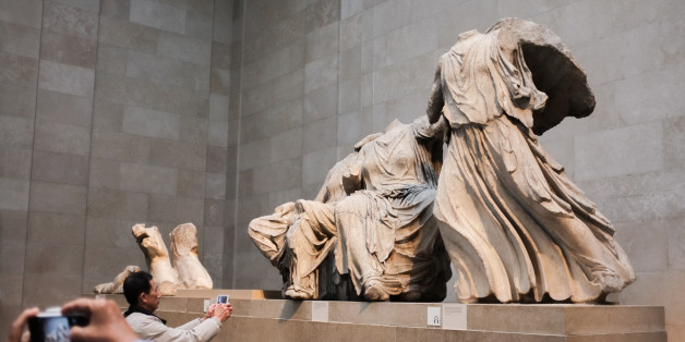 Tourists visit the Parthenon gallery at the British Museum in London, on March 30, 2015. A legal team in Athens is currently trying to have the marbles returned to Greece (Photo by Jay Shaw Baker/NurPhoto) (Photo by NurPhoto/NurPhoto via Getty Images)