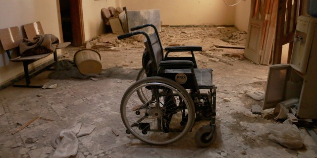 ALEPPO, SYRIA - OCTOBER 01: An unusable wheel chair is seen inside the Sahra Hospital after a barrel bomb strike by Syrian regime forces over Sahur neighborhood of Aleppo, Syria on October 01, 2016.  (Photo by Jawad Al-Rifai/Anadolu Agency/Getty Images)