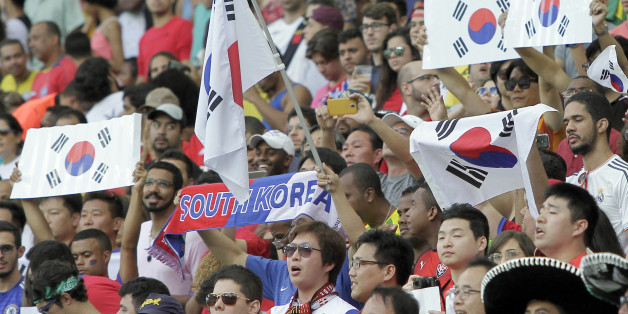 Fans of South Korea cheer before the group C match of the men's Olympic football tournament between Germany and South Korea at the Fonte Nova Arena in Salvador, Brazil, Sunday, Aug. 7, 2016. (AP Photo/Arisson Marinho)