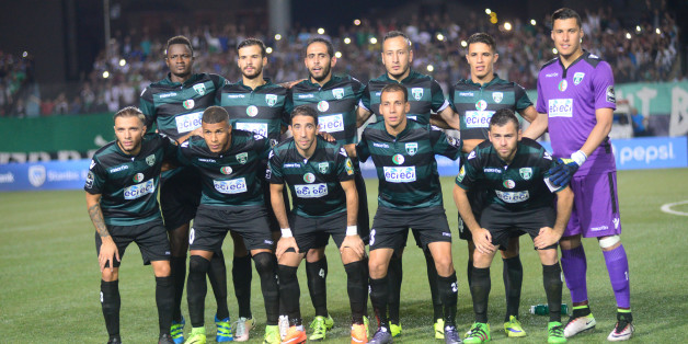 CORRECTION - Soccer team MO Bejaia poses for photographers before their game against FUS Rabat in the first leg of the 2016 Caf Confederation Cup semifinal at the Stade de l'Unite Maghrebine, in the Algerian city of Bejaia on September 18, 2016. / AFP / stringer / The erroneous mention[s] appearing in the metadata of this photo by stringer has been modified in AFP systems in the following manner: [MO Bejaia] instead of [FUS Rabat]. Please immediately remove the erroneous mention[s] from all your