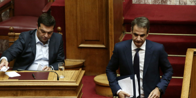 Greek PM Alexis Tsipras  (L) and Kyriakos Mitsotakis, New Democracy and main opposition leader, during a debate on education in the Greek Parliament, in Athens on September 28  (Photo by Panayiotis Tzamaros/NurPhoto via Getty Images)