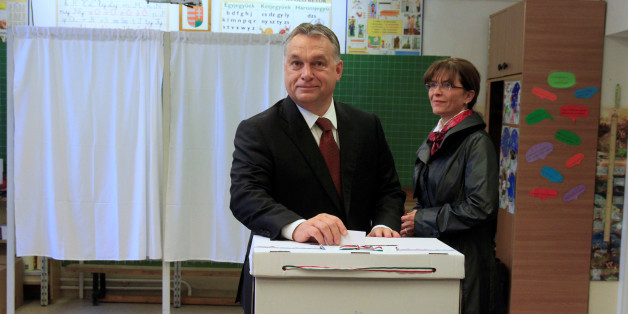 Hungary's Prime Minister Viktor Orban casts his ballot next to his wife Aniko Levai inside a polling station during a referendum on EU migrant quotas in Budapest, Hungary, October 2, 2016. REUTERS/Bernadett Szabo