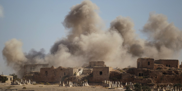 Smoke rises behind the ancient castle of the rebel-controlled town of Maaret al-Numan after airstrikes in Idlib province, Syria, September 25, 2016. REUTERS/Khalil Ashawi