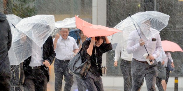 Pedestrians holding umbrellas struggle against strong wind and heavy rains caused by Typhoon Malakas in Nagoya, central Japan, in this photo taken by Kyodo September 20, 2016.  Mandatory credit Kyodo/via REUTERS  ATTENTION EDITORS - THIS IMAGE WAS PROVIDED BY A THIRD PARTY. EDITORIAL USE ONLY. MANDATORY CREDIT. JAPAN OUT. NO COMMERCIAL OR EDITORIAL SALES IN JAPAN. TPX IMAGES OF THE DAY