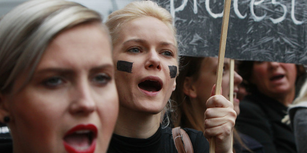 Polish women shout slogans during a nationwide strike and demonstration to protest a legislative proposal for a total ban on abortion in Warsaw, Poland, Monday, Oct. 3, 2016. Polish women are waging a nationwide strike with workers and students boycotting their jobs and classes and housewives refusing to do housework. (AP Photo/Czarek Sokolowski)