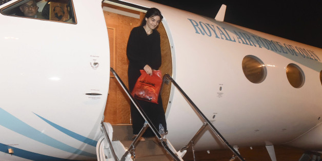 In this photo released by the Oman News Agency on Tuesday, Oct. 4, 2016, Nourane Houas who was kidnapped by a group of armed men in Yemen on Dec. 1, 2015, arrives at Muscat airport, Oman, after being released in Yemen. The French-Tunisian woman working for the Red Cross has been released after nearly a year in captivity in Yemen, the International Committee of the Red Cross said late Monday. (Oman News Agency via AP)