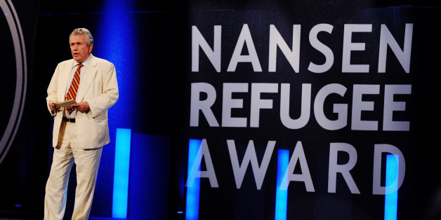 GENEVA, SWITZERLAND - OCTOBER 03:  In this handout image provided by the UNHCR, Martin Bell gives speech during the 2011 Nansen Refugee Award ceremony on October 3, 2011 in Geneva, Switzerland. The prize was awarded to the founder and 290 staff of SHS, a non-governmental organization, for their life-saving work in helping the thousands of refugees and migrants who arrive on Yemen's shores each year.  (Photo by J Tanner/UNHCR via Getty Images)