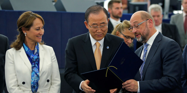 French Minister for Environment and President of the COP 21 Segolene Royal (L), U.N. Secretary General Ban Ki-moon (C), and European Parliament President Martin Schulz pose for a picture after the vote in favor of the Paris U.N. COP 21 Climate Change agreement of the European Parliament in Strasbourg, October 4, 2016. REUTERS/Vincent Kessler