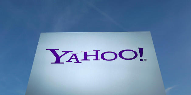 A Yahoo logo is pictured in front of a building in Rolle, east of Geneva, Switzerland December 12, 2012.   REUTERS/Denis Balibouse/File Photo